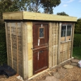 The shed with a green roof