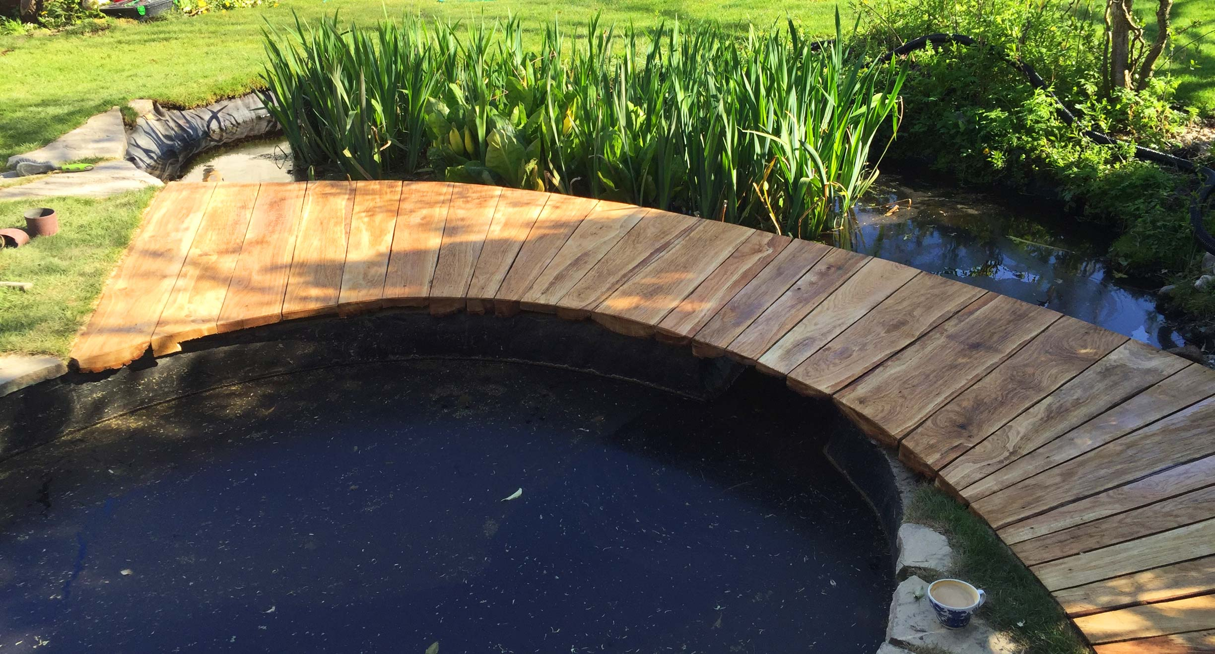 Gardening services in brighton - garden pond & wooden bridge walkway
